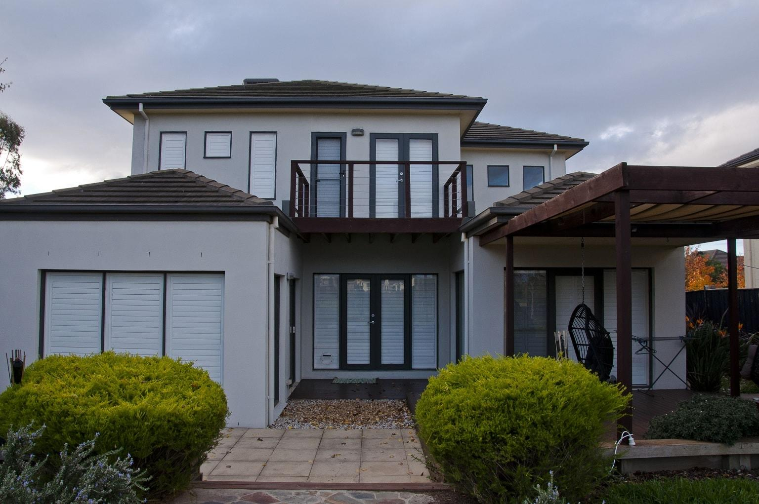 Plantation Shutters Installed into a Two Story House - External View - Window Shutters Closed