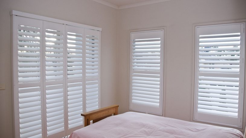 Various Custom Sized Window and Door Plantation Shutters Installed in Master Bedroom