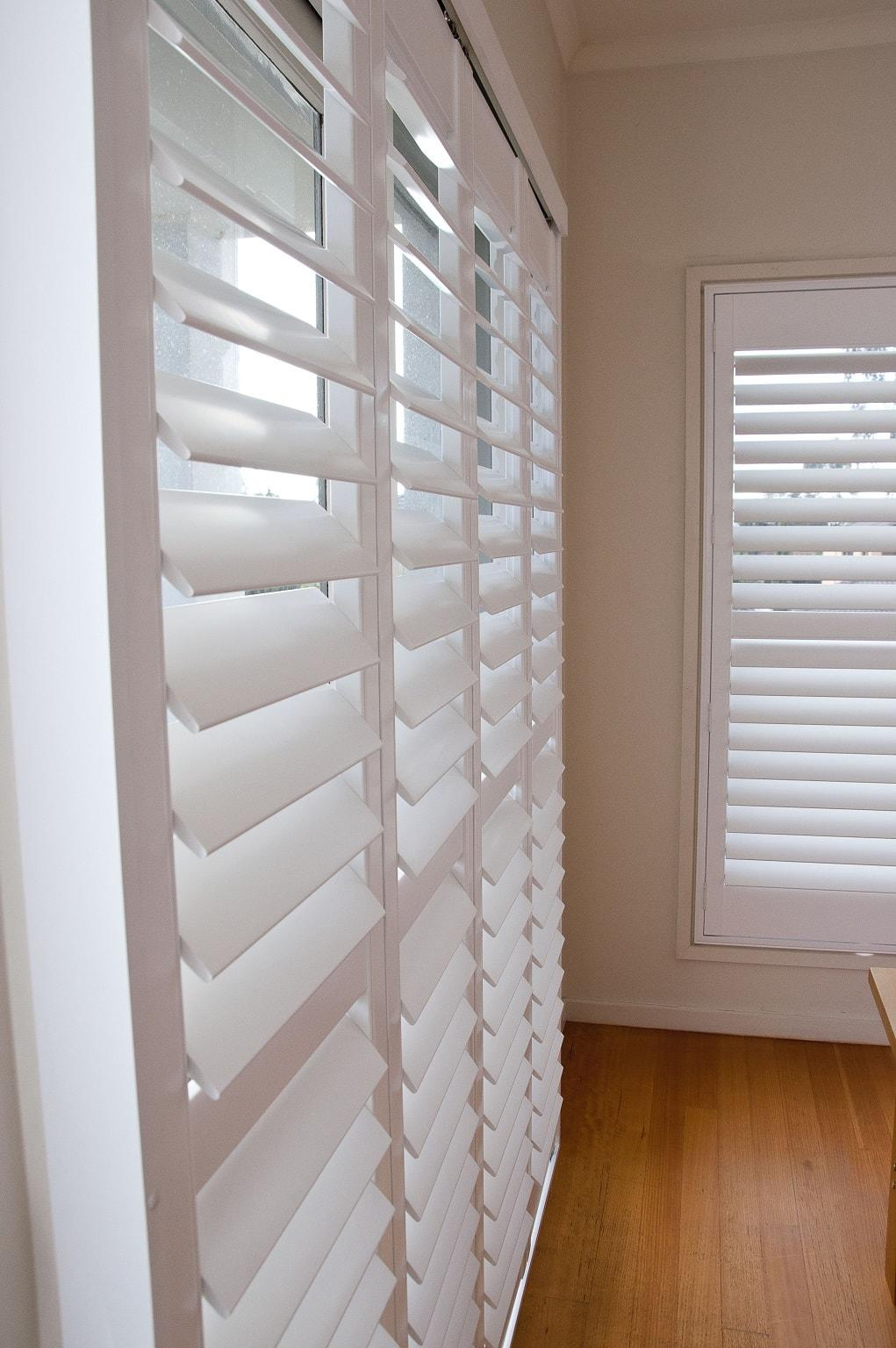 Various Custom Sized Window and Door Plantation Shutters Installed in Master Bedroom 2
