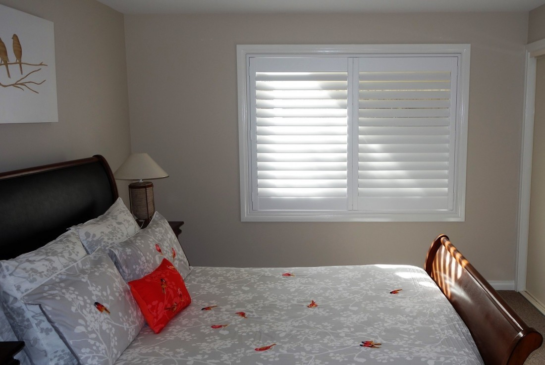 Double Window Plantation Shutters installed in a Double Bedroom